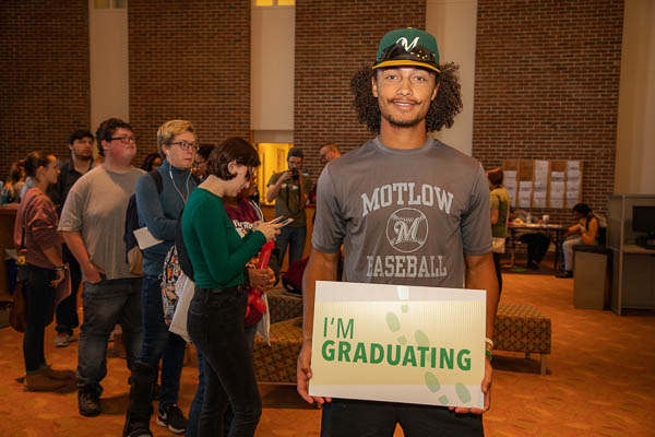 "Motlow student athlete holding ""I'm Graduating"" sign"