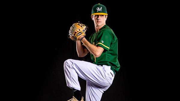 Motlow student athlete preparing to pitch baseball