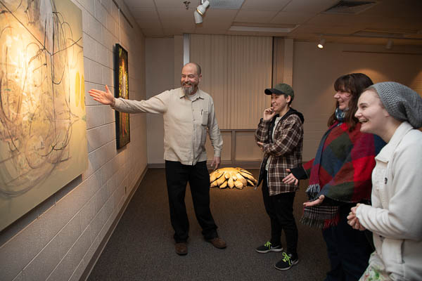 Motlow students view an art exhibit in Eoff Hall