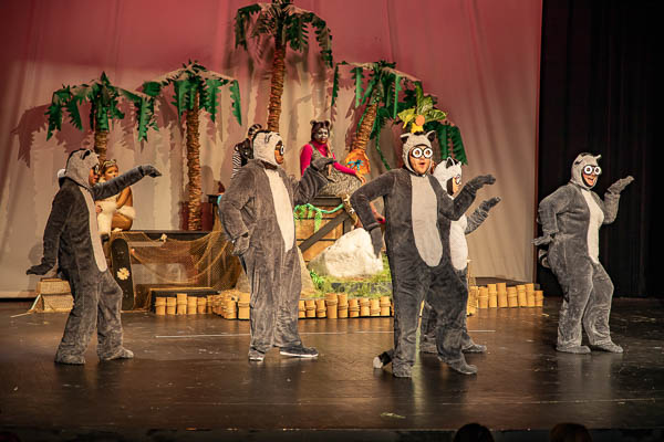 Motlow students dancing on stage dressed as lemurs for Madagascar