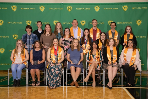 Group of PTK graduates pose for photo