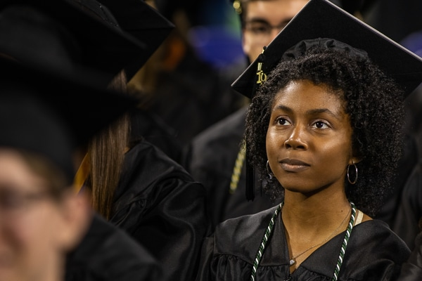 Motlow graduate intensly watching ceremony