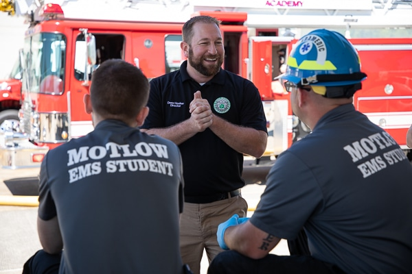 EMT instructor talking to student in the field